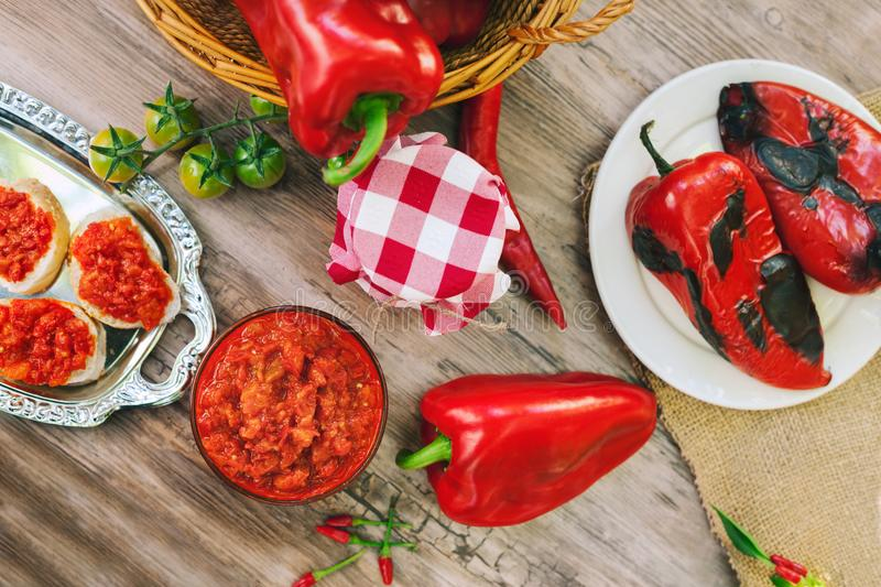 Ajvar in bowl and spread on bread royalty free stock photo
