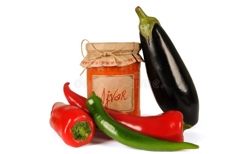 Ajvar - delicious dish of red and green peppers, onions, garlic, eggplant. Ajvar in jar. royalty free stock photography