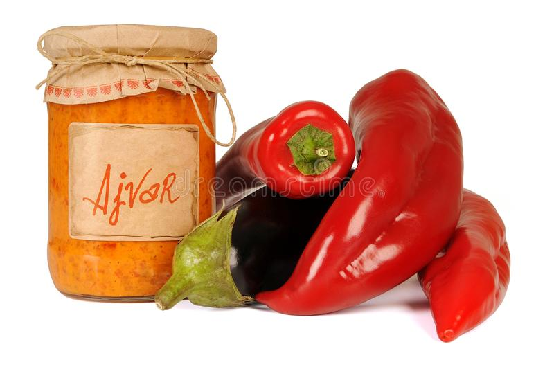 Ajvar - delicious dish of red and green peppers, onions, garlic, eggplant. Ajvar in jar. Ajvar, a delicious roasted red pepper and eggplant dish. Serbian and stock photography