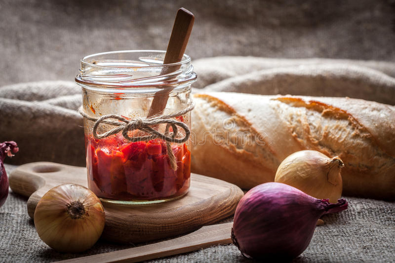 Ajvar. Ajvar - delicious dish of red peppers, onions and garlic royalty free stock photo