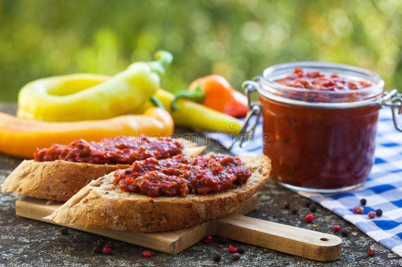 Ajvar - delicious dish of roasted red peppers. Spread on bread stock images