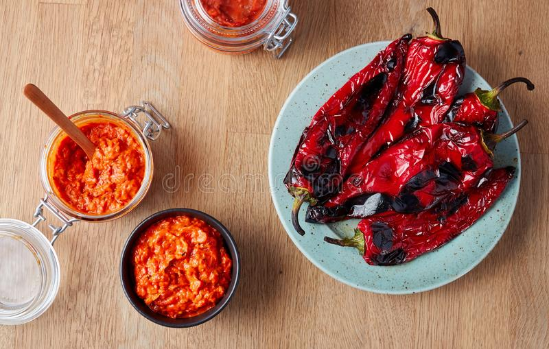 Roasted Red Pepper Relish Ajvar. Ajvar - delicious dish of roasted red peppers on table royalty free stock photos
