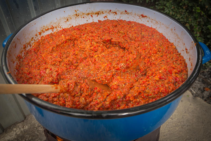 Ajvar. Mashed and cooked peppers, in the process of making delicious traditional Balkan food - ajvar stock image