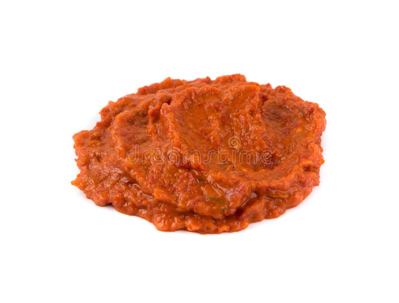 Ajvar or Pindjur Orange Vegetable Spread made from Bell Peppers. Eggplants and oil. Marinara sauce, salsa, chutney or lutenica isolated close up royalty free stock photography