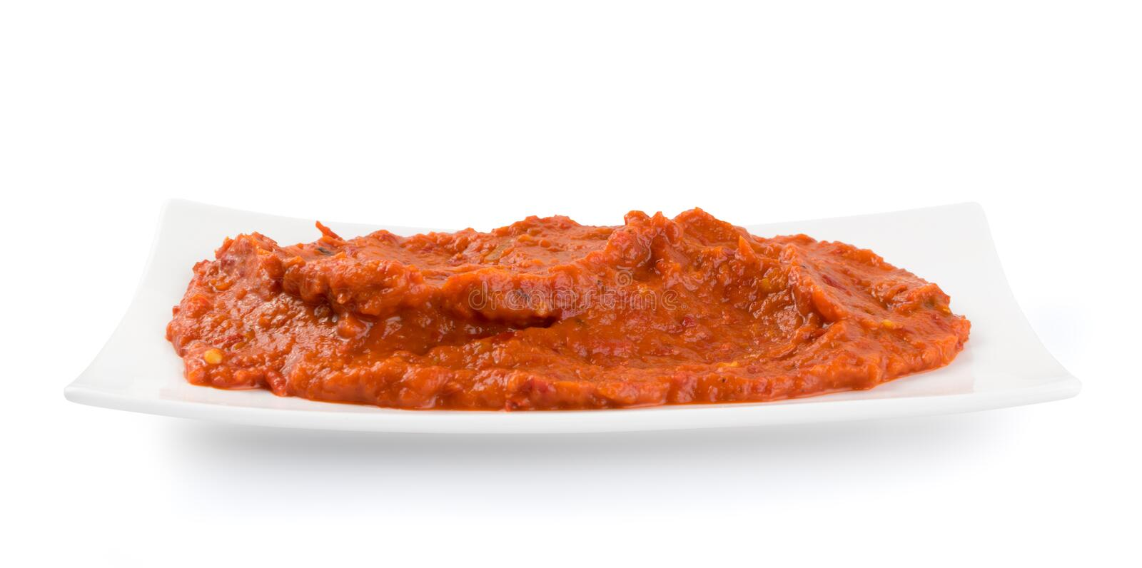 Ajvar or Pindjur Orange Vegetable Spread made from Bell Peppers. Eggplants and oil. Marinara sauce, salsa, chutney or lutenica isolated royalty free stock image