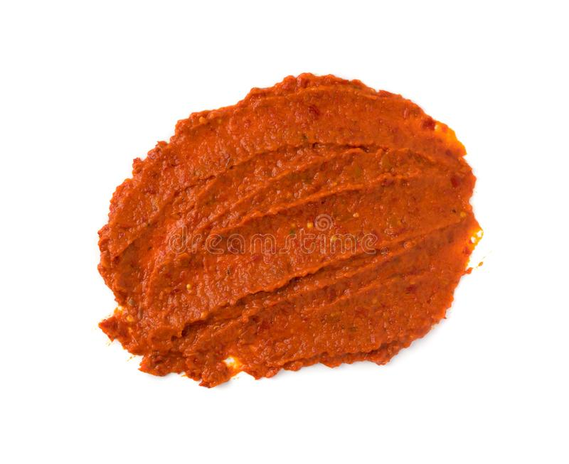 Ajvar or Pindjur Orange Vegetable Spread made from Bell Peppers. Eggplants and oil. Marinara sauce, salsa, chutney or lutenica top view isolated stock images