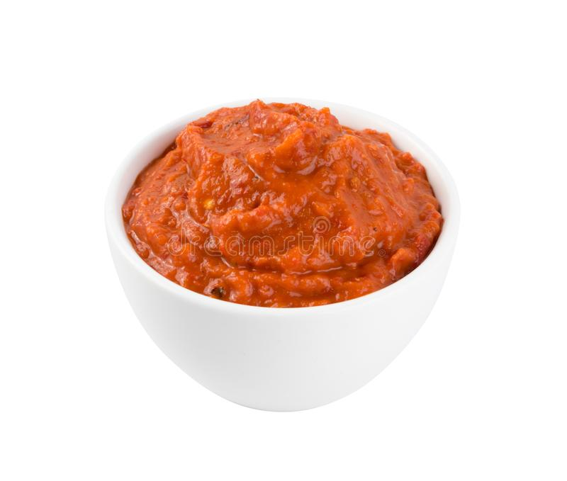 Ajvar or Pindjur Orange Vegetable Spread made from Bell Peppers. Eggplants and oil. Marinara sauce, salsa, chutney or lutenica in white bowl isolated stock photos