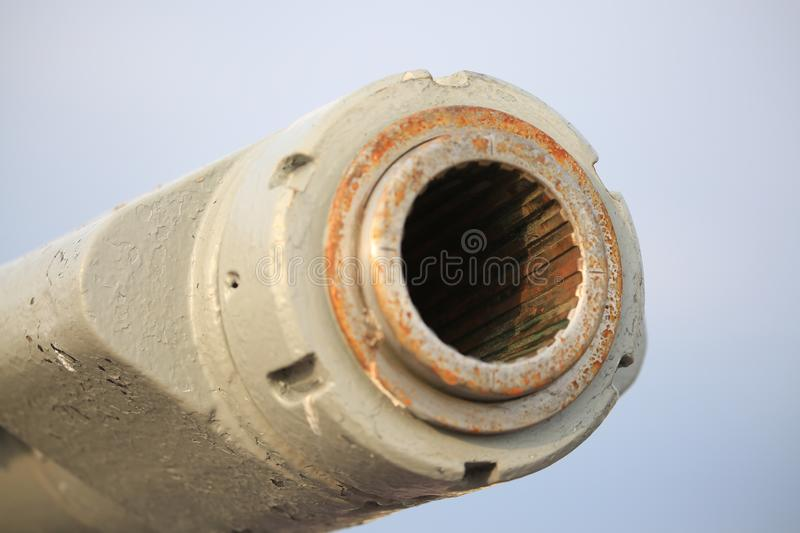 AK-176 dual purpose main naval gun. Muzzle close-up on the sky background stock photography
