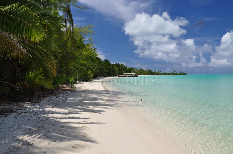 Akaiami in the Aitutaki Lagoon - Cook Islands. Motu Akaiami in the Aitutaki Lagoon with white sand, clear water, palm trees stock image