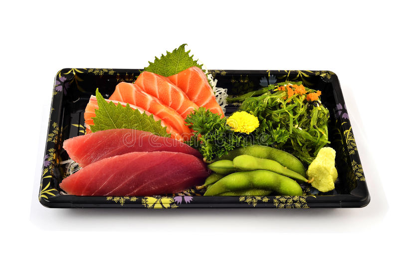 Akami or tuna and Salmon Sashimi fill with Pigeon pea and spicy Seaweed salad Japanese tradition food in delivery low cost box set. With white isolated royalty free stock image