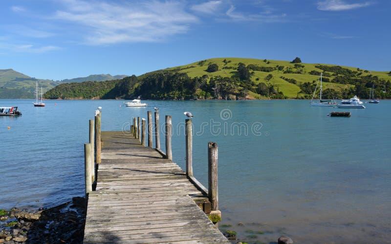 Akaroa Jetty, Canterbury New Zealand stock images