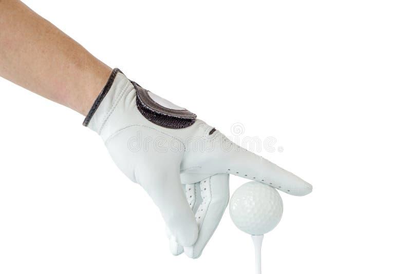Akcja golfista ręka w białej rękawiczce i piłce golfowej z trójnikiem zdjęcia royalty free