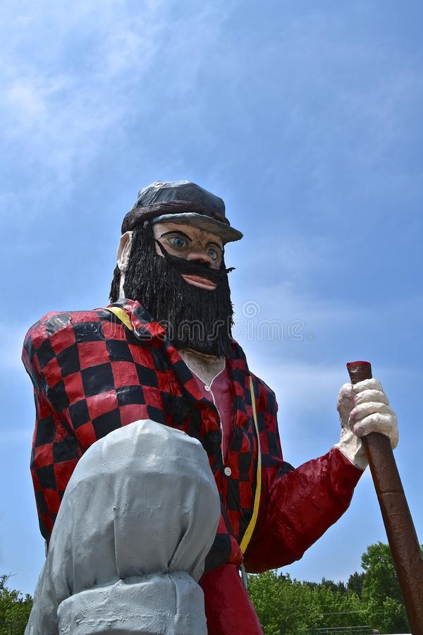 Statue of Paul Bunyan. AKELEY, MINNESOTA, June 14, 2018: The statue of Paul Bunyan is found in Akeley, MN at the Memorial Park managed bu the local Chamber of royalty free stock photography