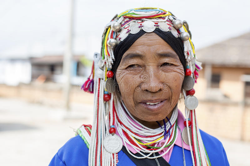 Akha Hill Tribe Lady, Myanmar. Kengtung, Myanmar - January 22, 2016. A portrait of an Akha hill tribe woman at Kengtung market in Myanmar. The Akha are an stock photos