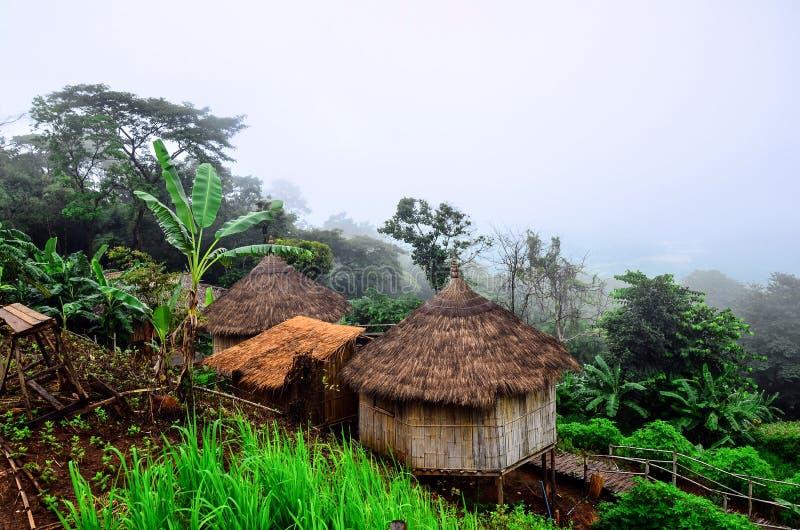 Akha homestays located on a hillside covered with fog at Doi Sa Ngo , Chiang Rai , Thailand royalty free stock photography