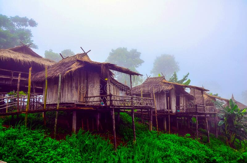 Akha homestays located on a hillside covered with fog at Doi Sa Ngo , Chiang Rai , Thailand royalty free stock photography