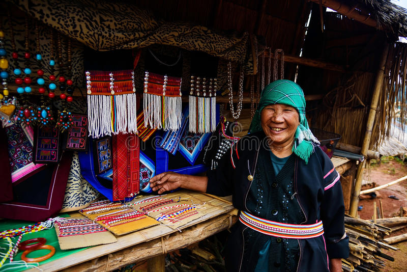 Akha tribe sell souvenir, Chiang Rai. CHIANG RAI, THAILAND - JANUARY 05, 2017: Unidentified Akha tribe woman selling traditional indigenous souvenir products at royalty free stock photos