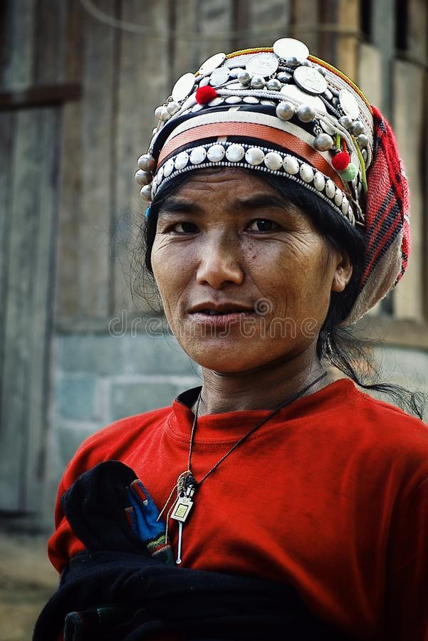 akha woman in front t of her home in the northern part of the country stock photo