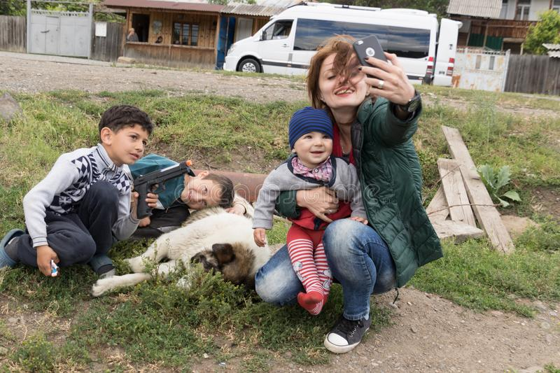 Akhaltsikhe, Georgia / June 12, 2017 - Woman takes selfie with t stock images