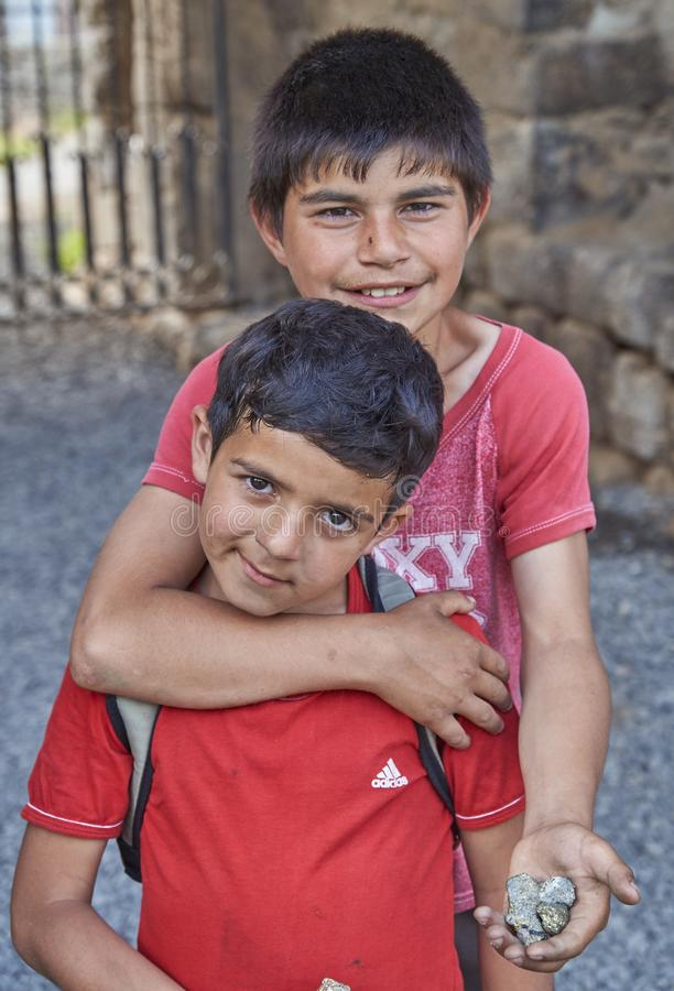 Akhtala,Armenia-6 june,2017. Poor armenian children sell chalcopyrite to foreigners royalty free stock photography