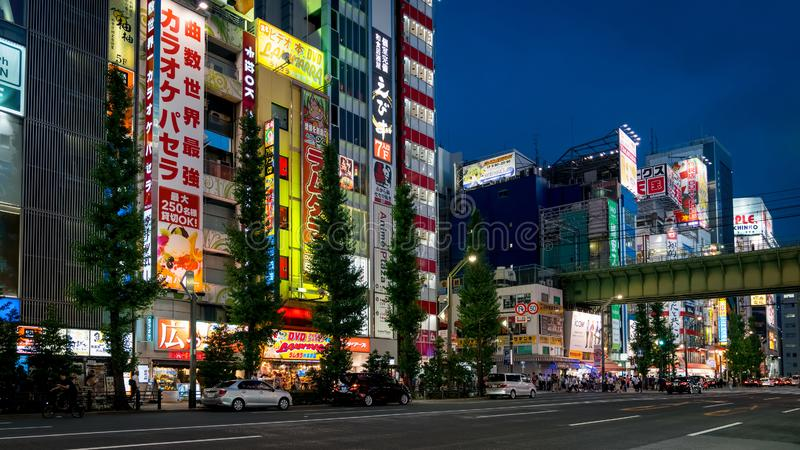 Akihabara Electric Town district in the evening with colorful lights and banners, Tokyo, Japan. Tokyo, Japan - August 2018: Akihabara Electric Town district in stock images