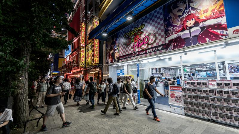 Akihabara Electric Town district in the evening with colorful lights and people, Tokyo, Japan. Tokyo, Japan - August 2018: Akihabara Electric Town district in royalty free stock images