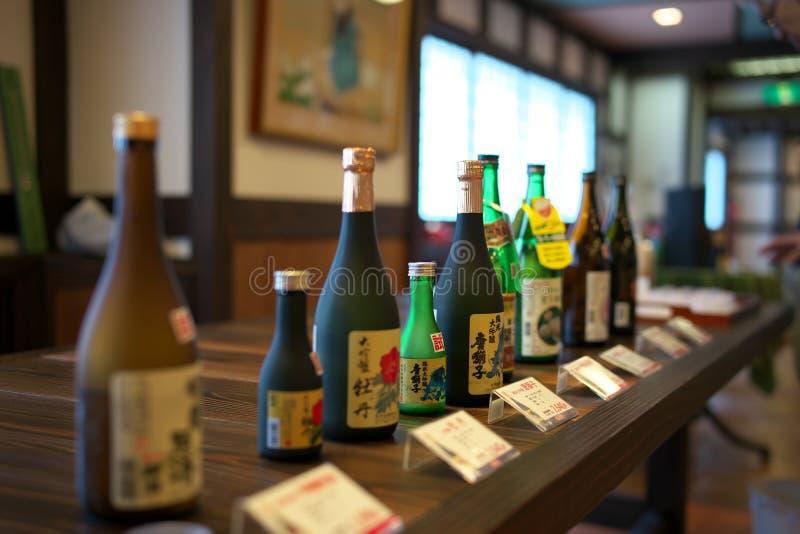 Sake bottles displayed at sake brewery in Akita, Japan royalty free stock photo