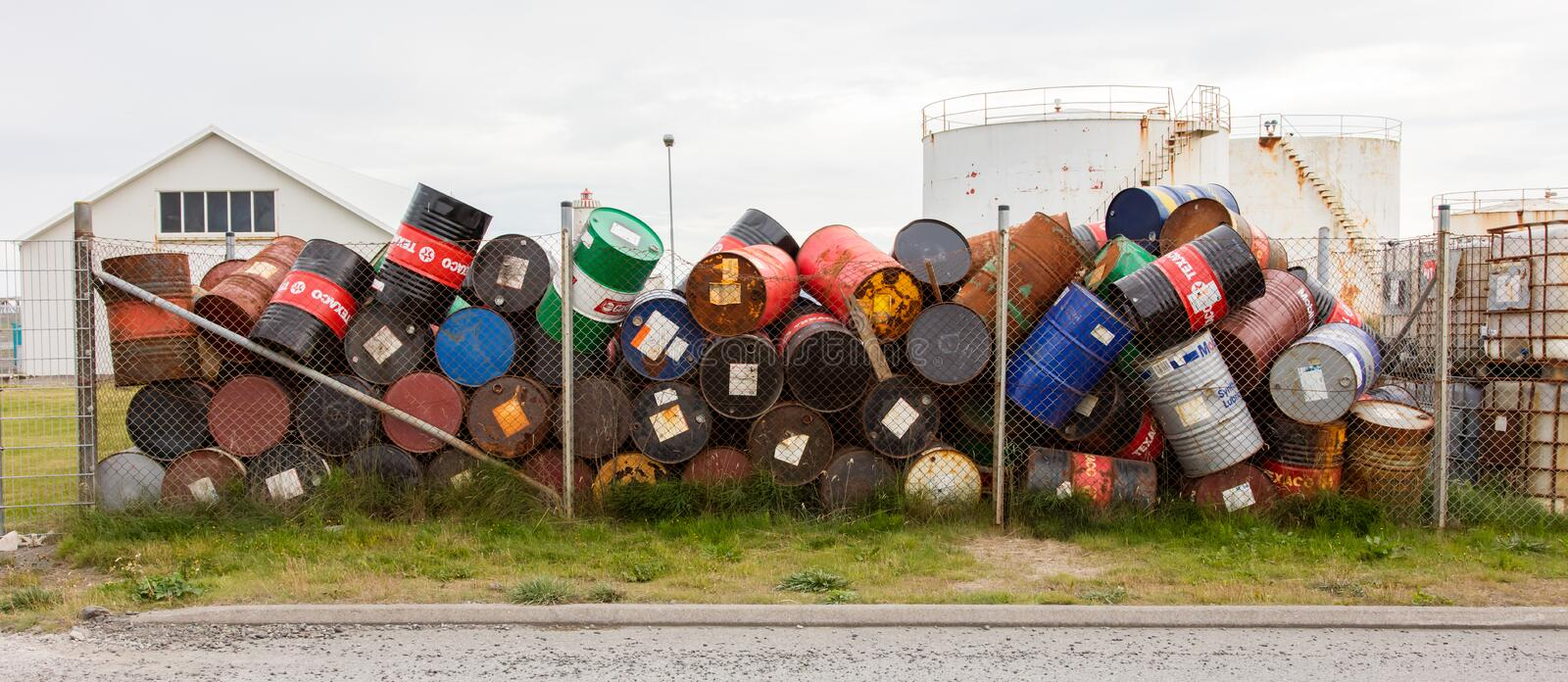 AKRANES, ICELAND - AUGUST 1, 2016: Oil barrels or chemical drums. Stacked up for cargo on August 1, 2016 stock images