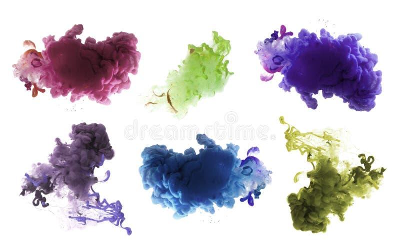 Akrylfärger och färgpulver i vatten abstrakt bakgrund royaltyfri fotografi