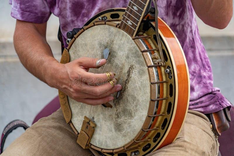 Aktör för banjospelaregata i nyc royaltyfri fotografi