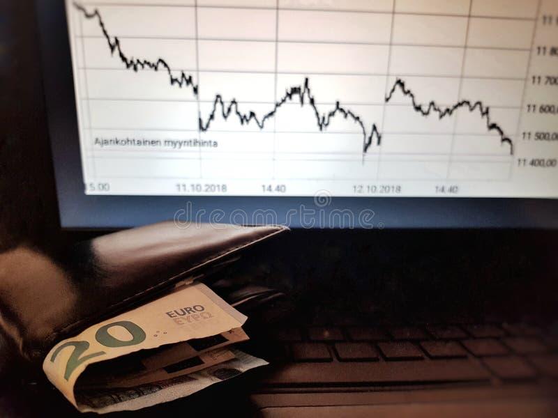 Aktienkurs und Geld stockbilder