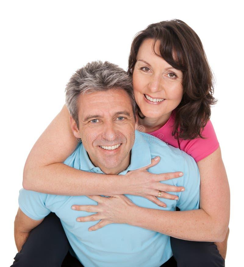 Aktiva mogna par som gör kondition royaltyfri bild