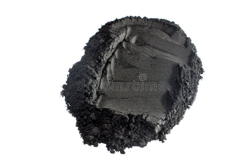 Aktywowany węgla drzewnego proszek strzelający z makro- obiektywem obraz royalty free