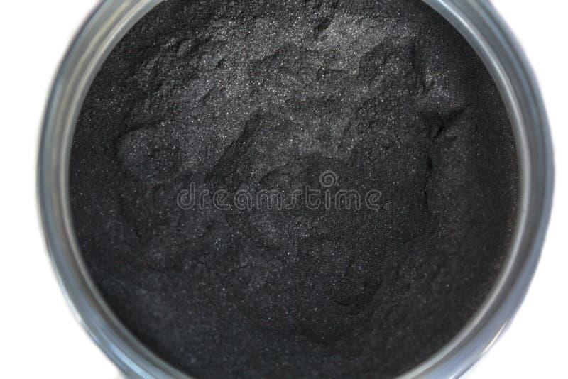 Aktywowany węgla drzewnego proszek w słoju zdjęcia stock