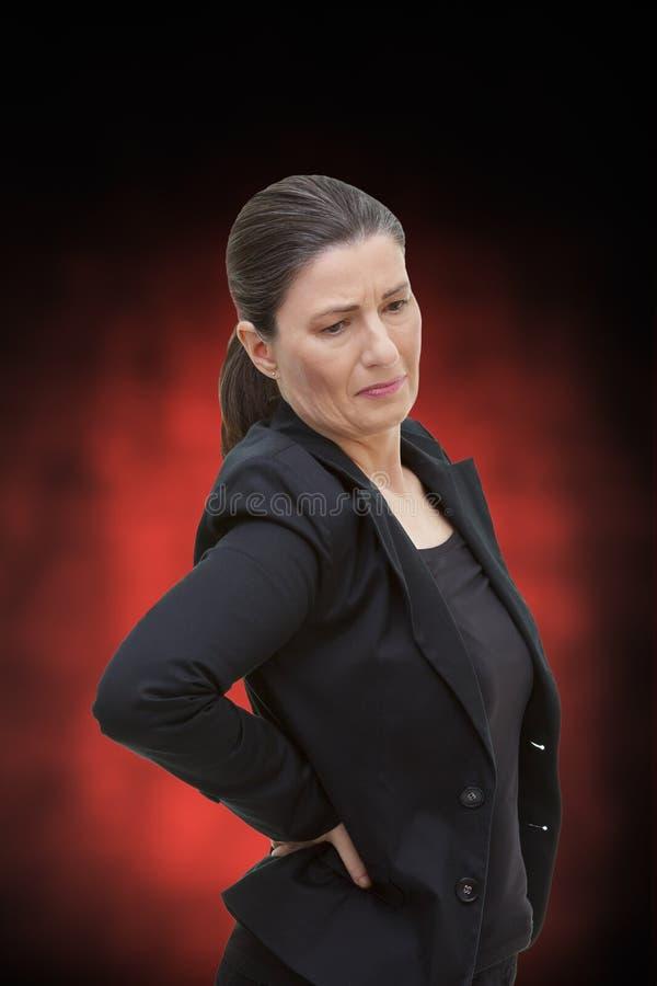 Akut kvinnaryggvärkryggskott smärtar royaltyfri foto