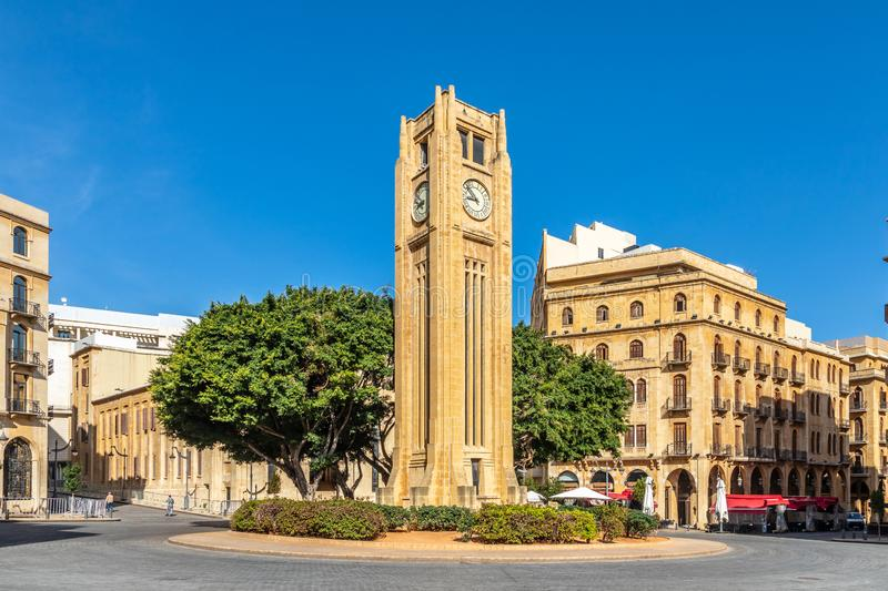 Al-Abed Nejmeh Square clock tower with tree and buildings around, Beirut, Lebanon. Arab, arabic, architecture, asia, attraction, capital, center, central stock images