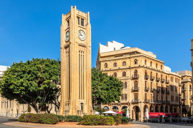 Al-Abed Nejmeh Square clock tower with tree and buildings around, Beirut, Lebanon. Arab, arabic, architecture, asia, attraction, capital, center, central royalty free stock photography