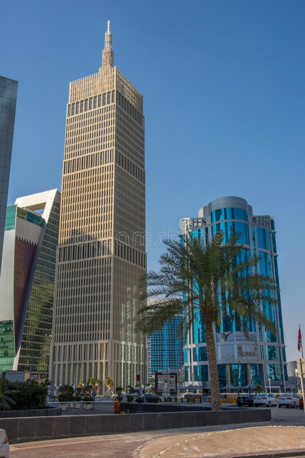 Al Asmakh Tower (IBQ Tower) skyscraper on blue sky background in Doha, Qatar. Al Asmakh Tower (IBQ Tower) Modern skyscraper on blue sky background in Doha, Qatar stock photos