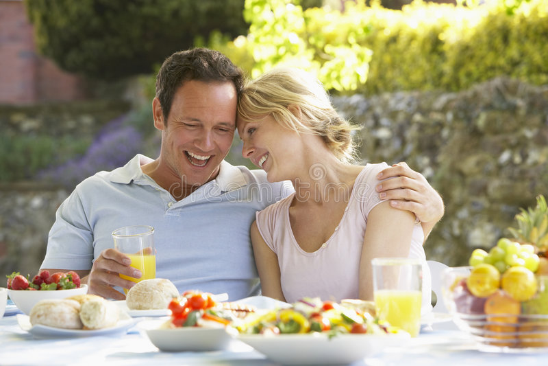 al couple eating fresco meal