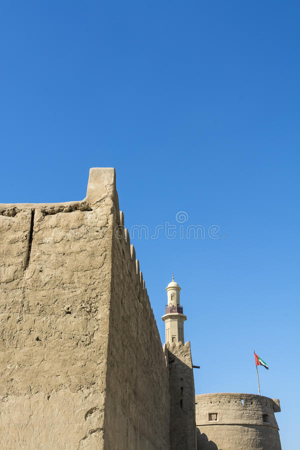 Al Fahidi fort, Dubai. 's oldest building dating from around 1787. In the background a minaret on the Juma Grand Mosque. The fort houses Dubai museum. Bur Dubai royalty free stock photos