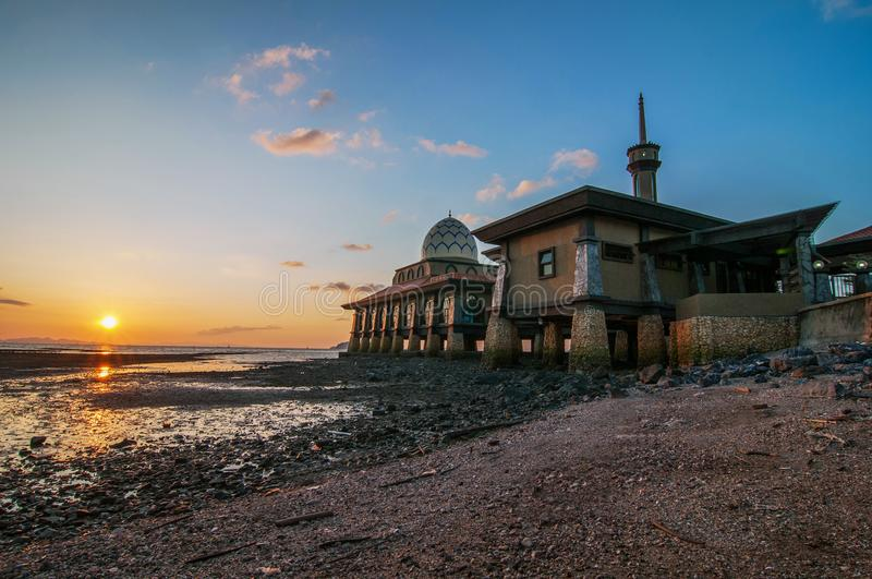 Al-Hussain Mosque by the sea with sunset views located in Perlis Malaysia. stock photography