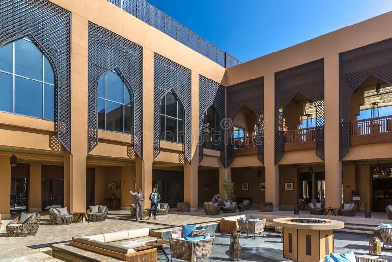Al Jabal, Oman - Jan 22nd 2018 - The open lobby of the Anantara hotel in Al Jabal in Oman in a blue sky day. royalty free stock photos