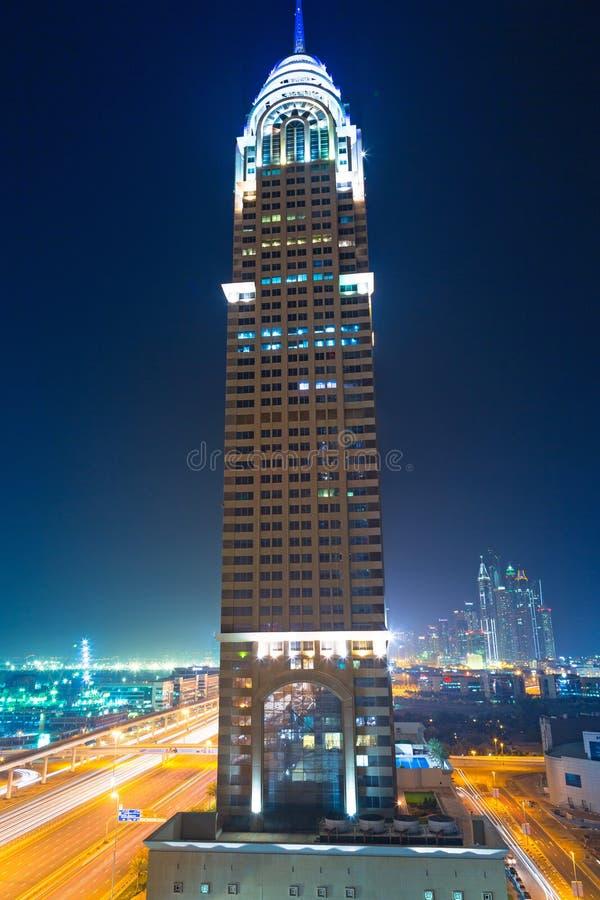 The Al Kazim Towers in Dubai Media City at night stock photos