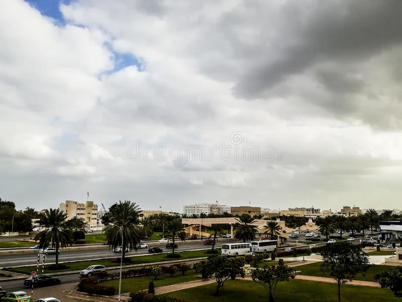 Al Khuwair Zawawi Mosque right view in front of Muscat main road. In cloudy weather having beautiful sky with greenery Muscat Oman raining in Muscat stock photo