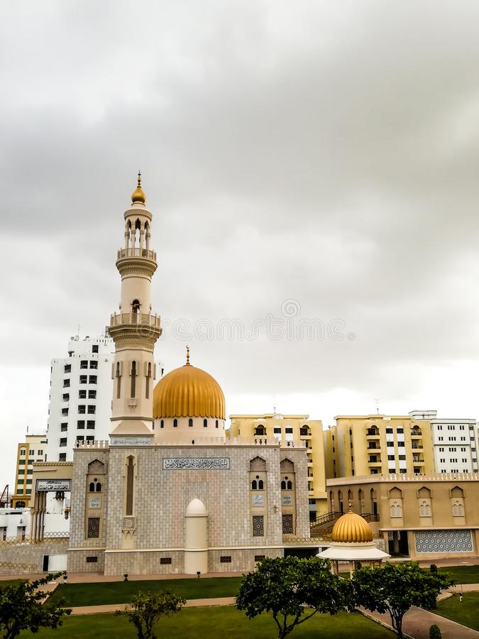 Al Khuwair Zawawi Mosque right view in front of Muscat main road. In cloudy weather having beautiful sky with greenery Muscat Oman raining in Muscat stock images
