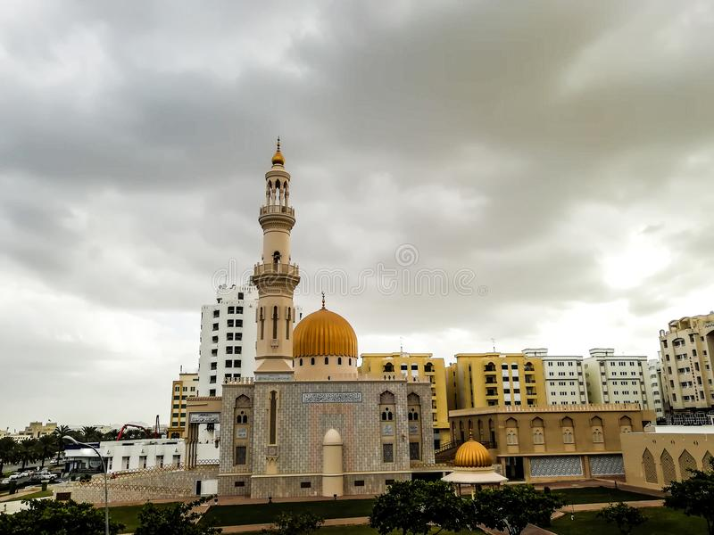 Al Khuwair Zawawi Mosque right view in front of Muscat main road. In cloudy weather having beautiful sky with greenery Muscat Oman raining in Muscat stock image