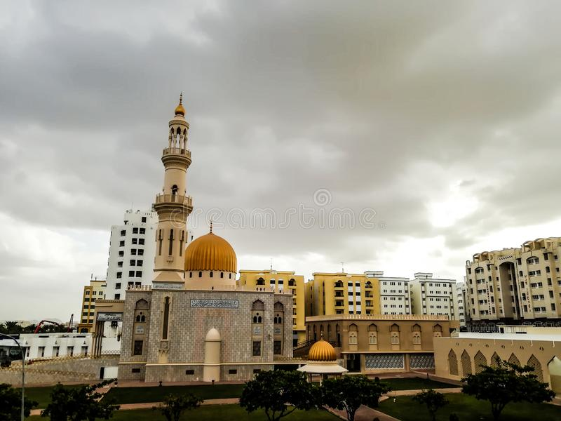 Al Khuwair Zawawi Mosque right view in front of Muscat main road. In cloudy weather having beautiful sky with greenery Muscat Oman raining in Muscat stock photos