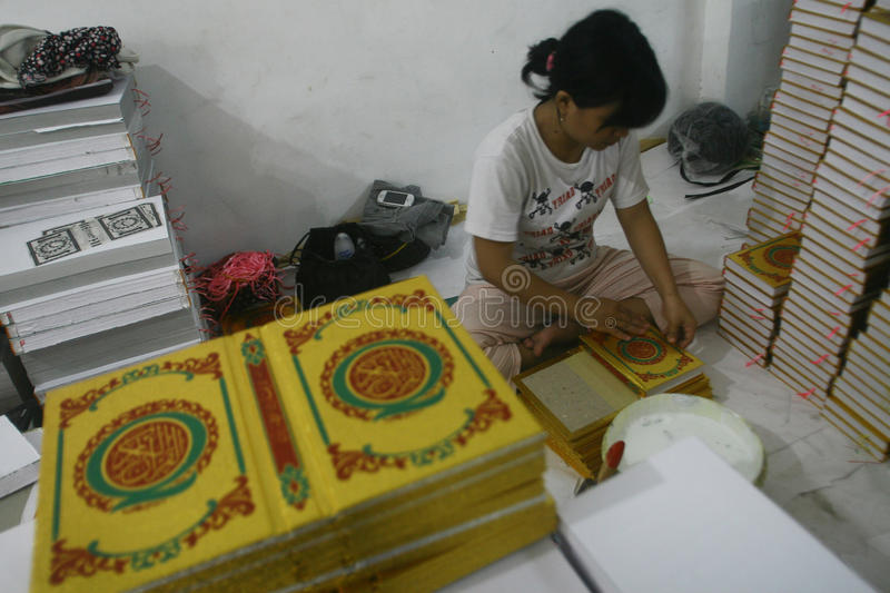 Al Quran Production In Indonesia. Workers complete the making of Al-Quran in a printing industry in Surabaya, East Java stock photo