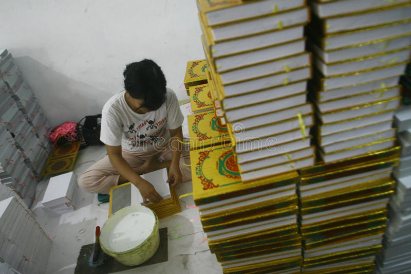 Al Quran Production In Indonesia. Workers complete the making of Al-Quran in a printing industry in Surabaya, East Java royalty free stock photography