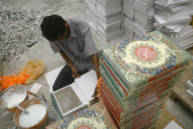 Al Quran Production In Indonesia. Workers complete the making of Al-Quran in a printing industry in Surabaya, East Java stock images